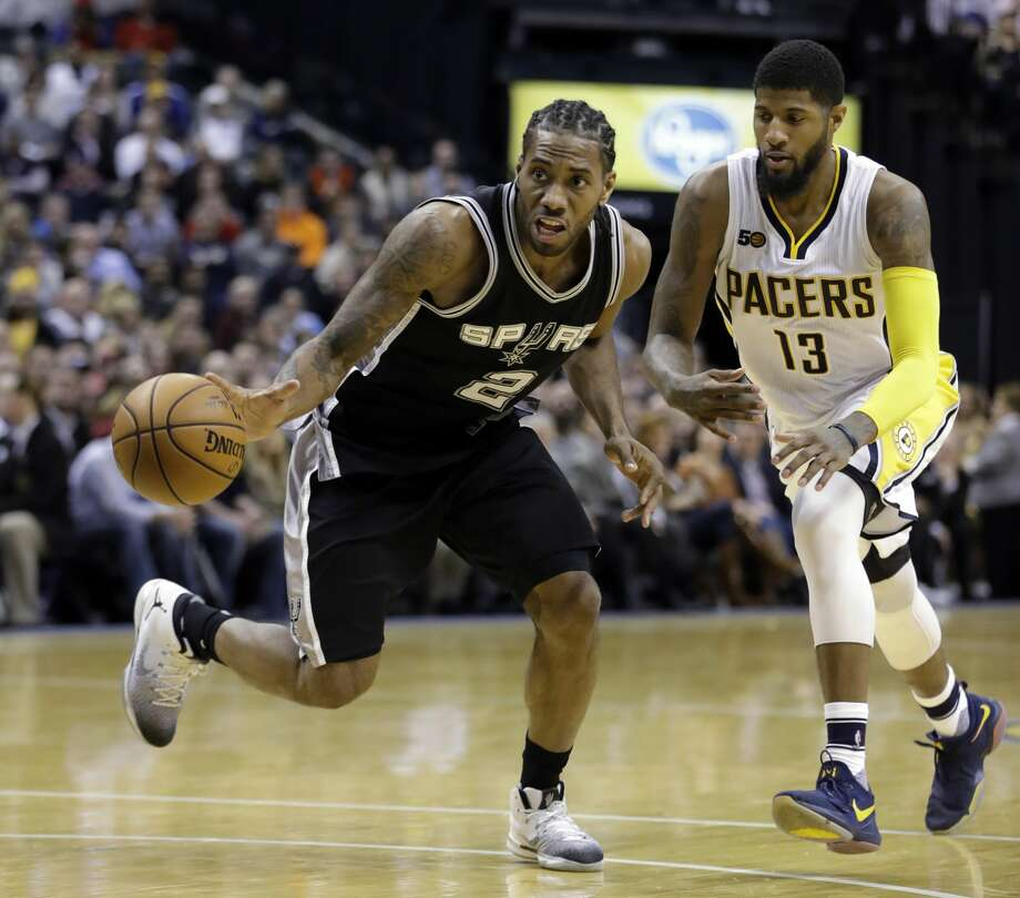 San Antonio Spurs' Kawhi Leonard is chased by Indiana Pacers' Paul George during the second half of an NBA basketball game, Monday, Feb. 13, 2017, in Indianapolis. San Antonio defeated Indiana 110-106. (AP Photo/Darron Cummings) Photo: Darron Cummings/Associated Press
