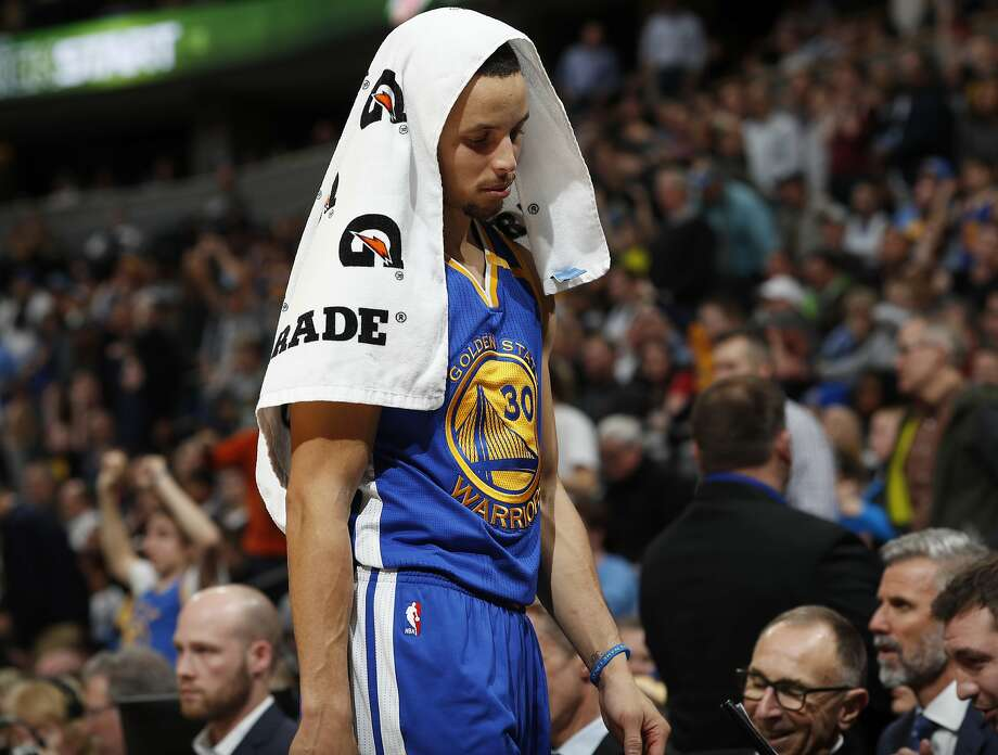 Golden State Warriors guard Stephen Curry heads to the bench with a towel over his head as the Warriors fell behind the Denver Nuggets in the second half of an NBA basketball game Monday, Feb. 13, 201, in Denver. The Nuggets won 132-110. Photo: David Zalubowski, Associated Press