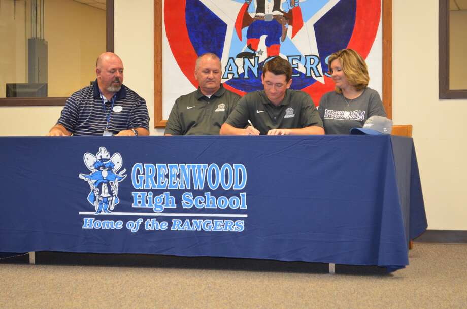 Greenwood golfer Colby Karcher signs with Southwestern Oklahoma State University during a signing ceremony at Greenwood High School on Monday, Feb. 13.