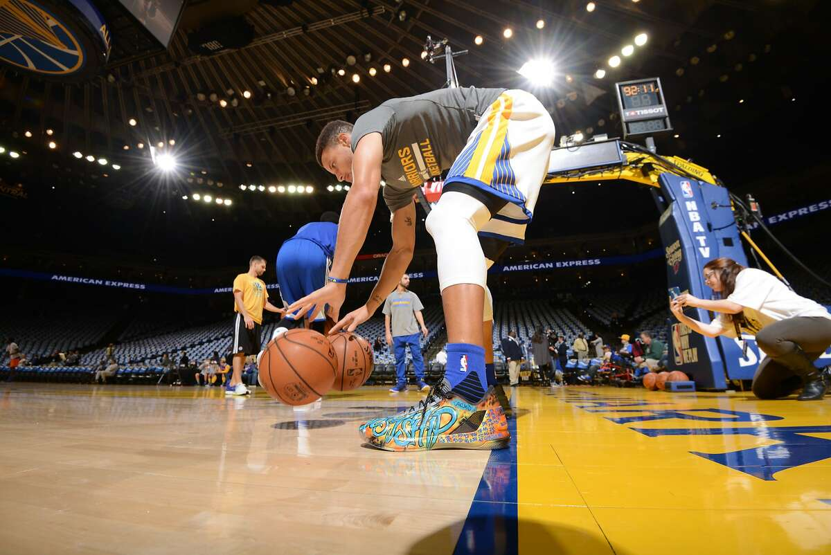 """Golden State Warriors point guard Steph Curry wears his commemorative pre-game """"Ghost Ship"""" Curry 3s."""