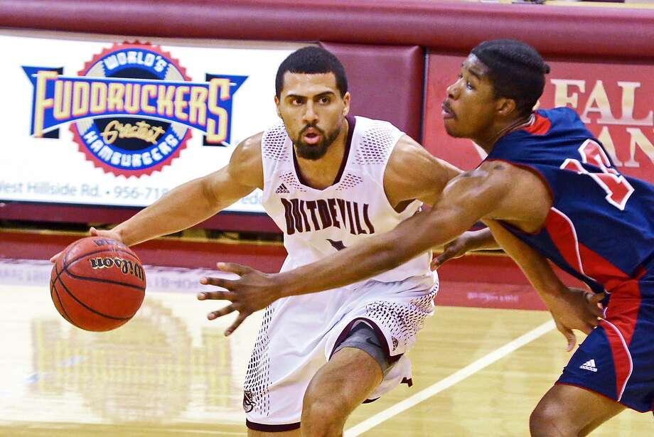 Arthur Santanna scored 16 points in TAMIU's win during Saturday's season finale at Newman. The Dustdevils claimed the No. 2 seed in the Heartland Conference tournament and square off in Tulsa next Thursday against seventh-seeded St. Mary's at 7:30 p.m. Photo: Cuate Santos /Laredo Morning Times File / Laredo Morning Times