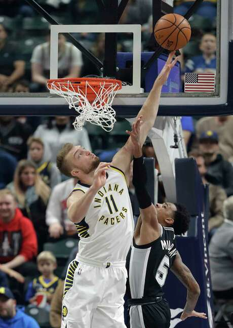 San Antonio Spurs' Dejounte Murray , right, shoots over Indiana Pacers' Domantas Sabonis (11) during the first half of an NBA basketball game, Sunday, Oct. 29, 2017, in Indianapolis. (AP Photo/Darron Cummings) Photo: Darron Cummings, Associated Press / Copyright 2017 The Associated Press. All rights reserved.