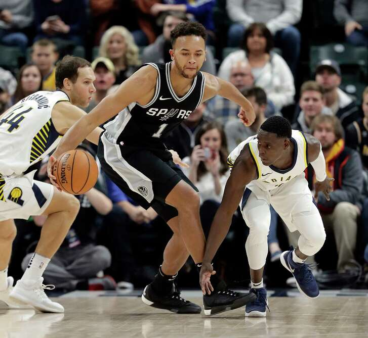 San Antonio Spurs' Kawhi Leonard is chased by Indiana Pacers' Paul George during the second half of an NBA basketball game, Monday, Feb. 13, 2017, in Indianapolis. San Antonio defeated Indiana 110-106. (AP Photo/Darron Cummings)