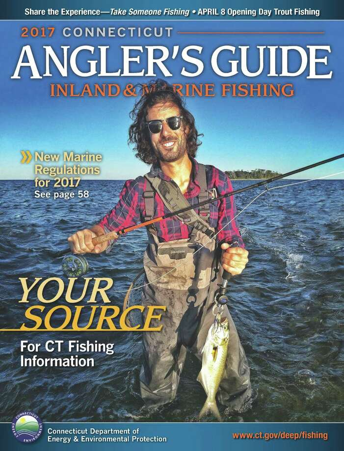 The cover of the 2017 Connecticut Angler's Guide shows Derek Angel of Avon, holding a bluefish caught fly-fishing the dropping tide at the Charles Island tombolo, Silver Sands State Park in Milford. It was the winning photos in hundreds of entries in the fourth annual contest by the state Department of Energy and Environmenatl Protection. Photo: Photo By Nick Walsh