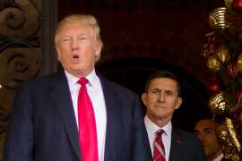 This file photo shows President Donald Trump with former National Security Adviser Lt. General Michael Flynn at Mar-a-Lago in Palm Beach, Florida.