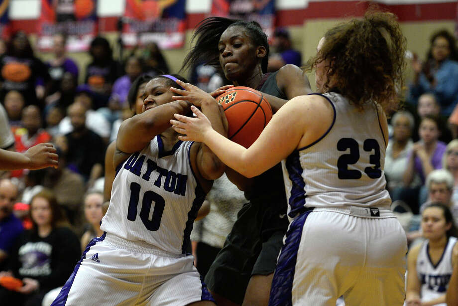 Central's Anastacia Mickens, center, struggles for the ball with  Dayton's Jayla Pruitt, left, and Alexis Trousdale during a class 5A girls basketball bi-district playoff game at Hardin-Jefferson High School on Monday night.  Photo taken Monday 2/13/17 Ryan Pelham/The Enterprise Photo: Ryan Pelham / ©2017 The Beaumont Enterprise/Ryan Pelham