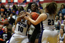 Central's Anastacia Mickens, center, struggles for the ball with  Dayton's Jayla Pruitt, left, and Alexis Trousdale during a class 5A girls basketball bi-district playoff game at Hardin-Jefferson High School on Monday night.  Photo taken Monday 2/13/17 Ryan Pelham/The Enterprise