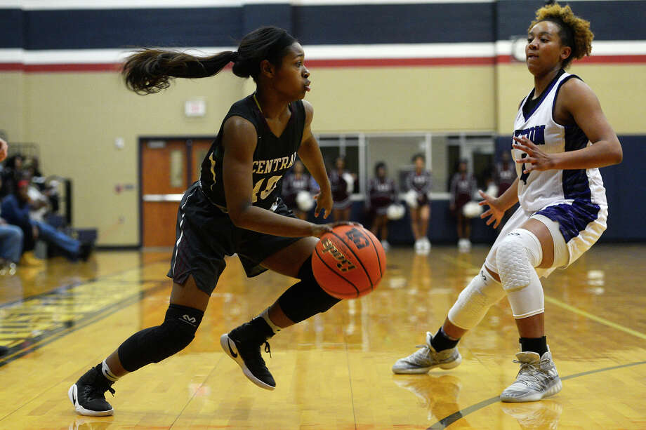 Central's Dereca Garrett is defended by Dayton's Tayelin Grays during a class 5A girls basketball bi-district playoff game at Hardin-Jefferson High School on Monday night.  Photo taken Monday 2/13/17 Ryan Pelham/The Enterprise Photo: Ryan Pelham / ©2017 The Beaumont Enterprise/Ryan Pelham