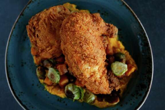 H-Town Hot Fried Chicken with garlic roasted butternut squash, brussels sprouts and bacon marmalade is on the menu at State Fare.