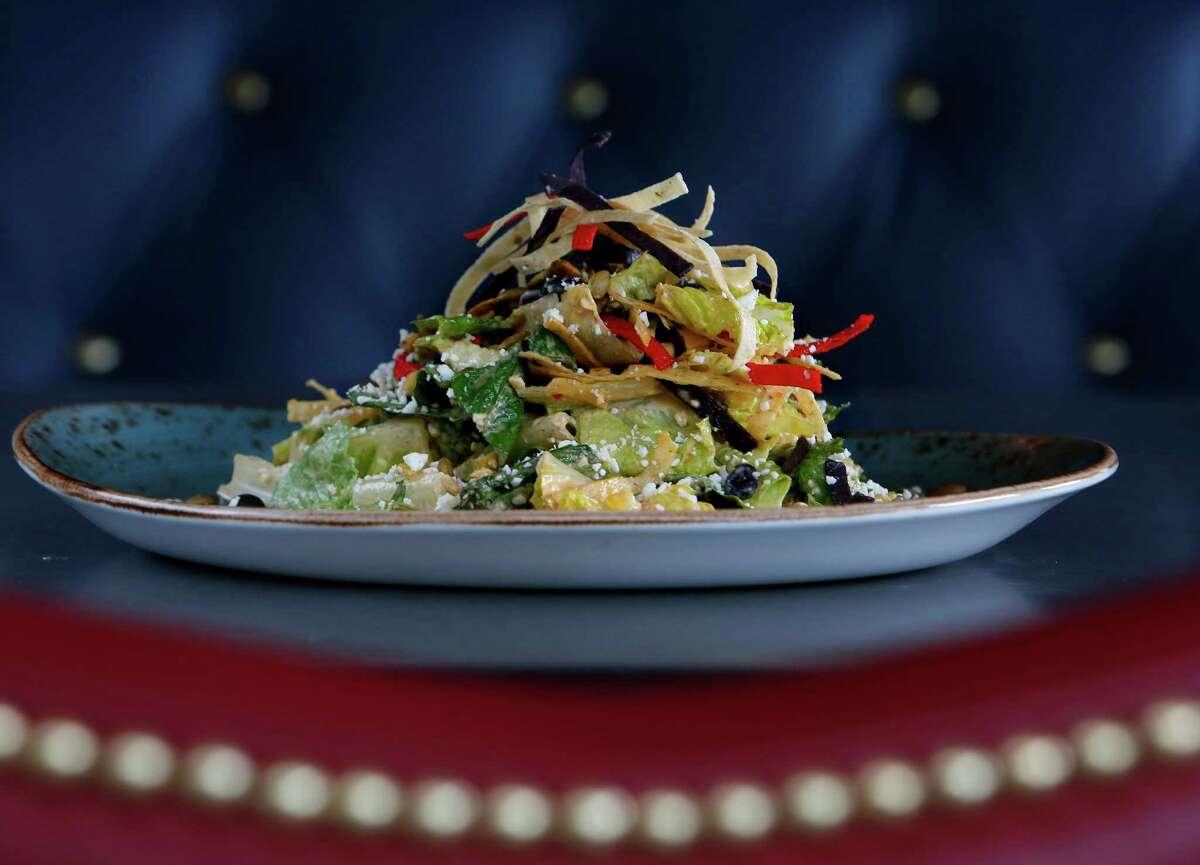 Jimmy's Original Southwest Caesar Salad has grilled corn, black beans, cotija, pepitas and tortilla strips.