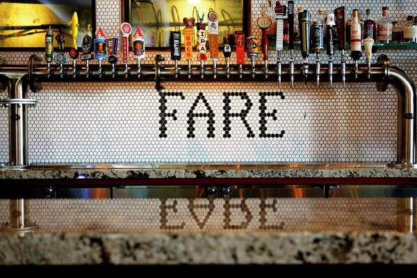 Fancy tile work adorns the wall behind the bar at State Fare.