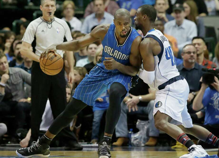 Orlando Magic forward Serge Ibaka (7) dribbles against Dallas Mavericks forward Harrison Barnes (40) during the second half of an NBA basketball in Dallas, Saturday, Feb. 11, 2017. Photo: LM Otero, AP / Copyright 2017 The Associated Press. All rights reserved.