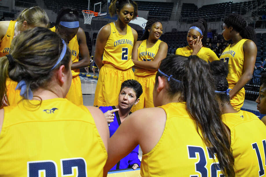 Cy Ranch head coach Tresa Hornsby coaches up her Mustangs during a timeout in Monday's bi-district playoff matchup against Houston Heights at Delmar Fieldhouse. Though the stadium's staff struggled with some logistical issues in the leadup to the contest, the game went off without a hitch, with Cy Ranch rolling to a 95-13 victory. Photo: Tony Gaines / HCN