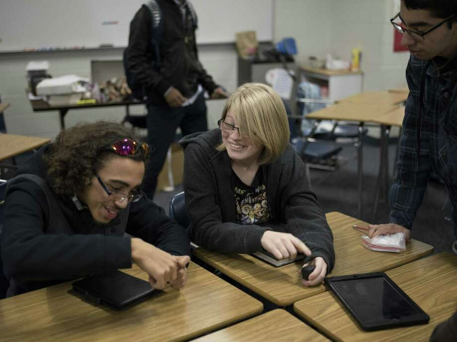 Alyssa Scott, 17 ( center), talks with friends Devon Howard and Isaac Coronado. Her family moved to San Antonio from California last year, and she was at risk of being ineligible to graduate on time. Photo: Photos By Matthew Busch / For The San Antonio Express-News / © Matthew Busch