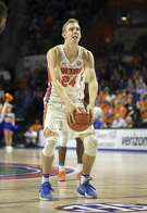 Florida guard Canyon Barry (24) goes old school with his underhand free throw during the second half against Missouri in Gainesville, Fla., on Feb. 2, 2017. Florida won 93-54.