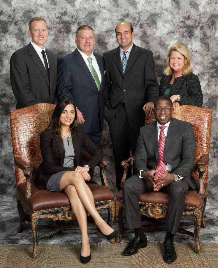 """The Fort Bend Chamber of Commerce has a sluate slate of member to its board of directors, including a new chairman. From left, standing, are: Ben Swan, treasurer; Mike Dobert, past-chair; Rehan Alimohammad, legal counsel, and Keri Schmidt, president/CEO; seated"""" Malisha Patel, chair-elect; Dr. Sterling Carter, chairman and Keri Curtis Schmidt, CCE, IOM. Photo: Randy Koslovsky., Owner / Randy Kozlovsky"""
