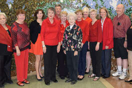 OakBend Medical Center will be the Private Reserve Port Sponsor for this year's Fort Bend County Wine from the Heart Event. From left are Sandy Scott, Jan McCleskey, Katy Todd, Patricia Orr, Steve Crow, Maggie Crow, Ann Council, Teri Grimes, Linda Drummond, Marian Wright, Marsha Beck, Sandy McCleskey and Sue McCarty