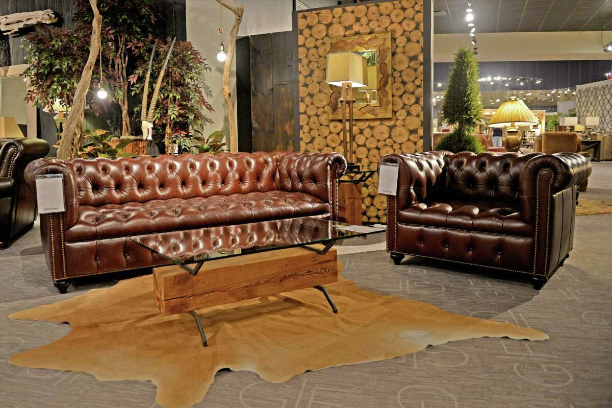 A leather sofa and chair were donated by Gallery Furniture to Morton Ranch Elementary School in Katy for the faculty lounge.