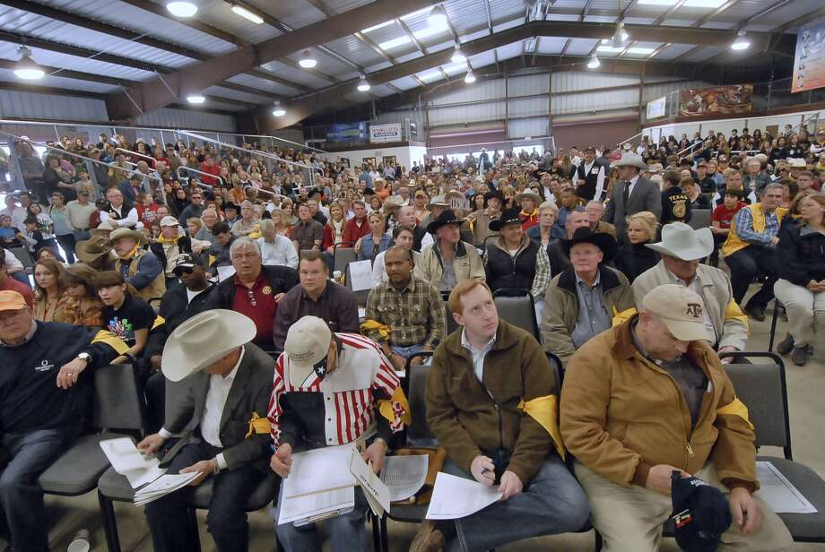 The Katy ISD FFA Livestock Show auction will be 1 p.m. Feb. 18 at the L.D. Robinson Pavilion, 6301 S. Stadium Lane. Above, the crowd at an earlier auction watches and prepares bids. Visit http://katyisdlivestockshow.org for details. Photo: Â Tony Bullard 2013, Freelance Photographer / © Tony Bullard & the Houston Chronicle