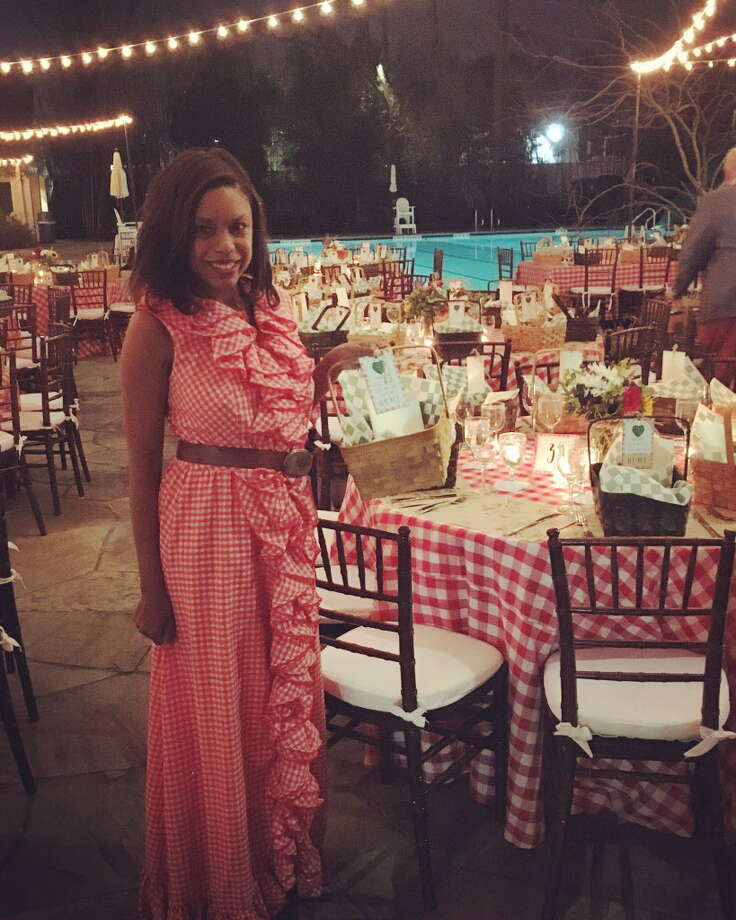 Society reporter Amber Elliott wears a gingham dress to the Memorial Park Conservancy's green gala at the Forest Club. Photo: Amber Elliott / Houston Chronicle