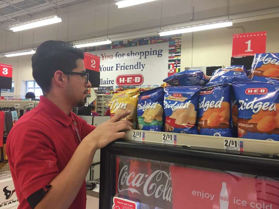 Jorge Reyes, 19, is an employee at the The HEB on Cedar Street. The store is closing to make way for an updated, multi-level store to open 2018. Photo: Jaimy Jones / HCN Staff