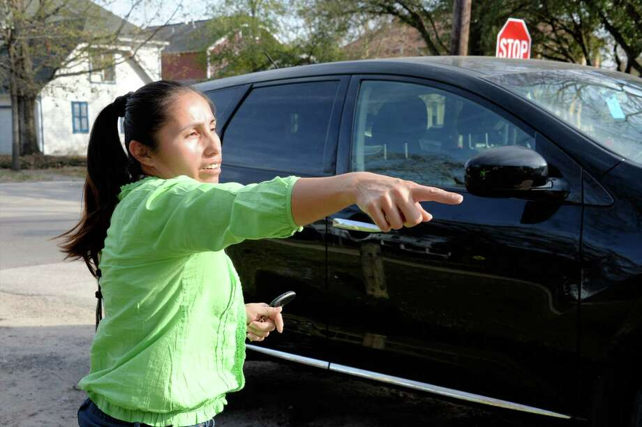 Gloria Carranza explains how robbers broke a window in her car, then later ripped her purse from her arms near Donovan Park on Heights Blvd. Houston, Texas on Wednesday, February 8, 2017 Photo: Craig Moseley, Staff / ©2017 Houston Chronicle
