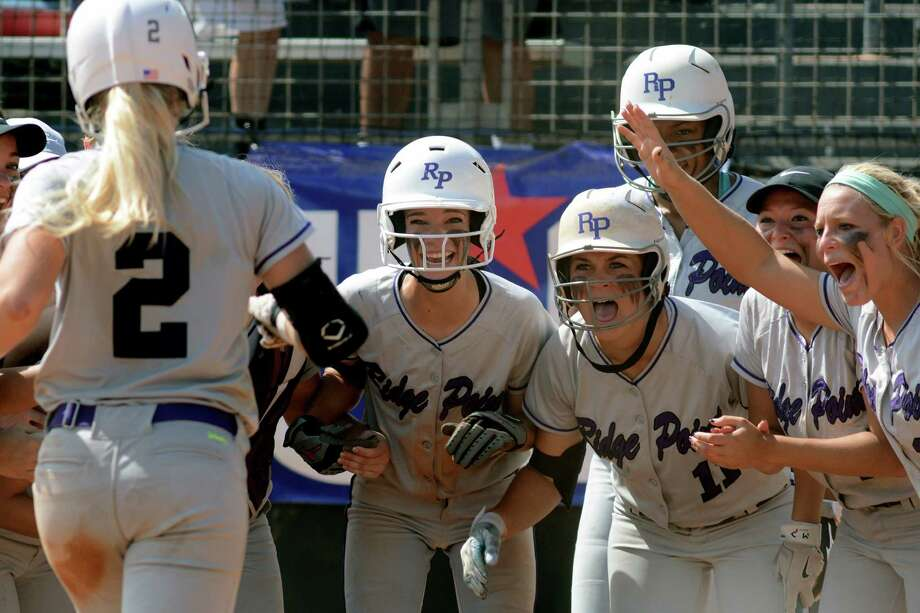 Ridge Point freshman pitcher Makinzy Herzog (2) heads for home plate where her teammates, including Abby Odneal, from left, Brooke Bushman, Gabby Garrison, Emily Flores, and Bri Nunn wait to greet her after her three-run homerun in the top of the 6th inning against Aledo during their Class 5A UIL State Softball Championship semi-final matchup at McCombs Field in Austin on Friday, June 5, 2015. (Photo by Jerry Baker/Freelance) Photo: Jerry Baker, Freelance