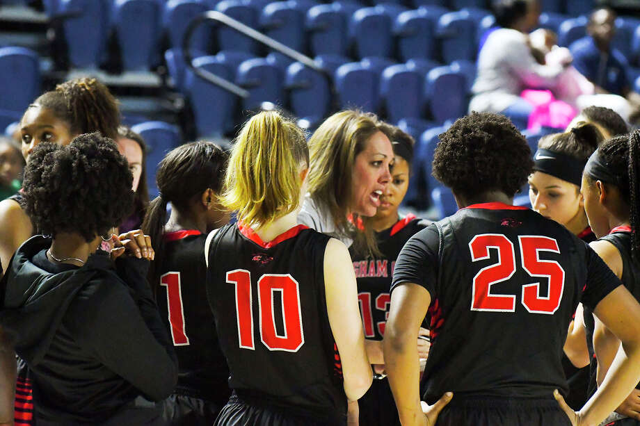 Langham Creek head coach Annette Steward coaches her Lobos up during a timeout in Monday's bi-district playoff match against Lamar. Immediately following a jaw-dropping 95-13 dismantling of Houston Heights by Cy Ranch, Langham Creek hung 88 points on the Texans, winning by 60 points, pushing Cy-Fair ISD's scoring margin over Houston ISD to 142 through the first two of four contests. Photo: Tony Gaines / HCN