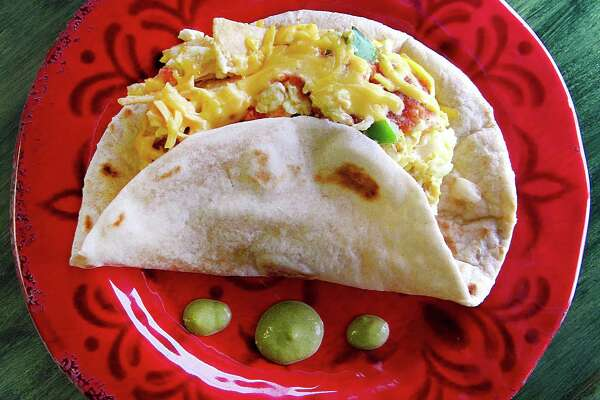 Chilaquiles taco on a handmade flour tortilla from Claudia's Restaurant on Pleasanton Road.