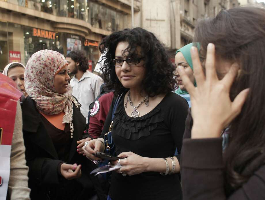 Mona Eltahawy, an Egyptian-born U.S. activist (center), is a fierce critic of the government. Photo: Maya Alleruzzo, Associated Press