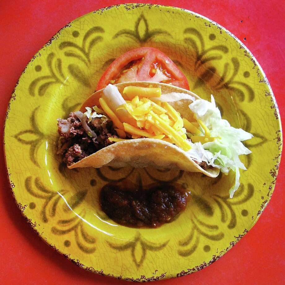 Crispy taco with beef picadillo from Mary Lou's Cafe. Photo: Mike Sutter /San Antonio Express-News