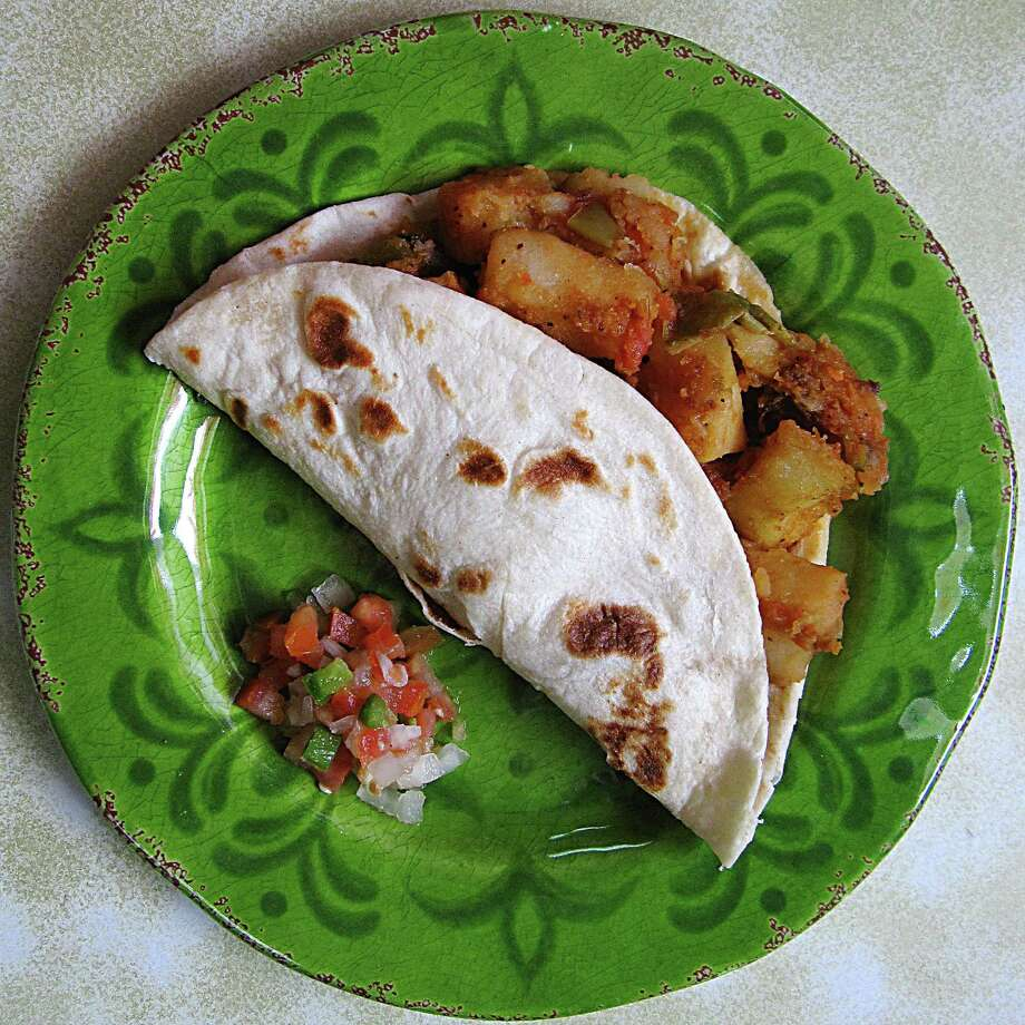Papas rancheras taco on a handmade flour tortilla from Cocula Jalisco. Photo: Mike Sutter /San Antonio Express-News