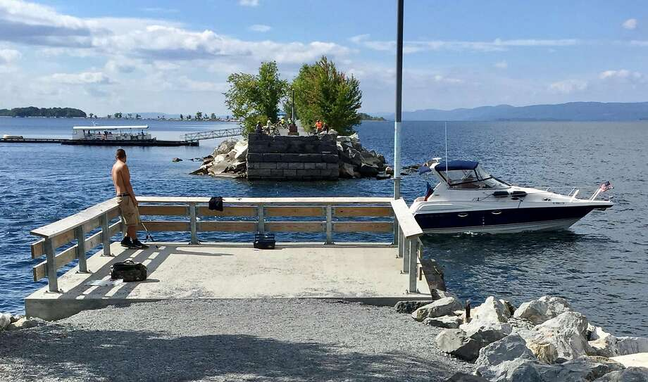 A pontoon ferry (left) connects a short break in the Island Line Trail bicycle route on Lake Champlain. Photo: Steve Rubenstein, The Chronicle