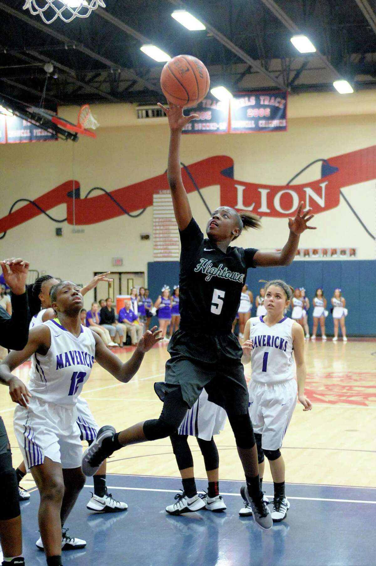Taelor Purvis (5) of Hightwwer drives to the hoop during the second half of the girls Bi-District playoff game between the Hightower Hurricanes and the Morton Ranch Mavericks on Monday February 13, 2017 at Alief Taylor High School, Houston, TX.