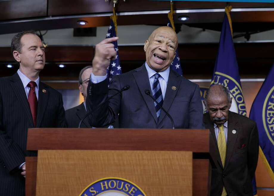 Rep. Elijah Cummings, D-Md., ranking member of the House Oversight and Government Reform Committee, flanked by Rep. Adam Schiff, D-Calif., ranking member of the House Intelligence Committee, left, and Rep. John Conyers, D-Mich., ranking member of the House Judiciary Committee, join other top House Democrats to say they want an investigation into President Donald Trump's relationship with Russia, including when Trump learned that his national security adviser, Michael Flynn, had discussed U.S. sanctions with a Russian diplomat, Tuesday, Feb. 14, 2017, during a news conference on Capitol Hill in Washington. (AP Photo/J. Scott Applewhite) Photo: J. Scott Applewhite, Associated Press