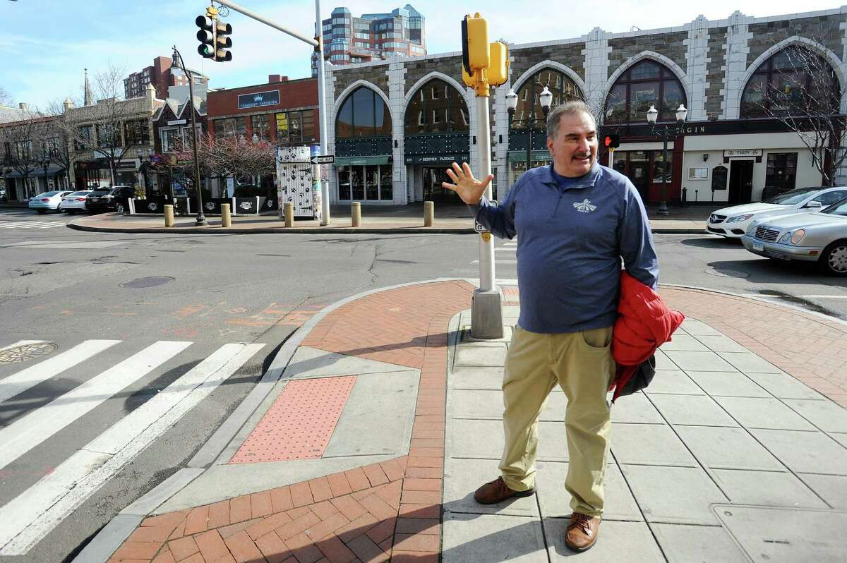 Eric Keshin, president of Great Harvest Bread, walks down Bedford Street in Stamford on Feb. 8 while discussing plans to open a location in the city.
