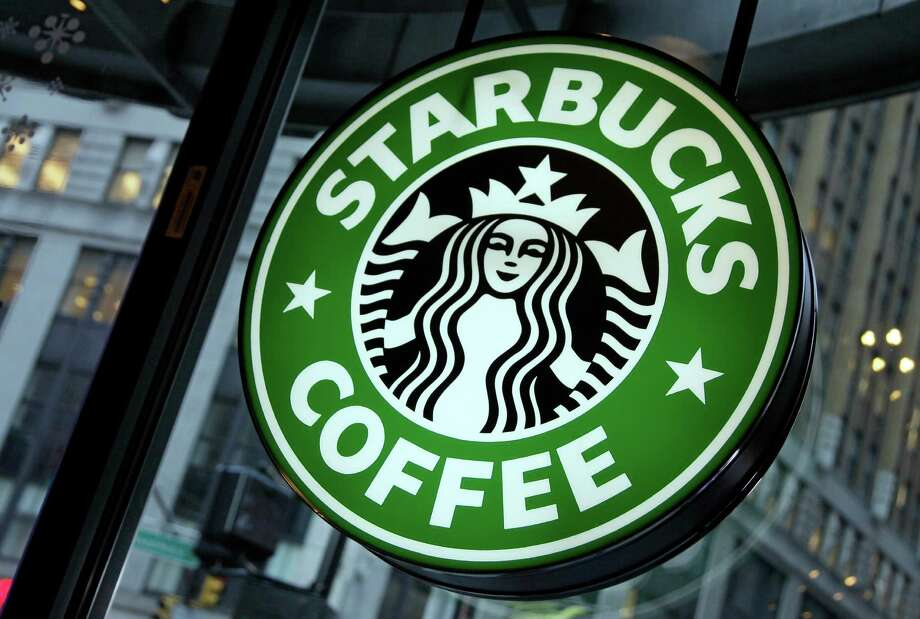 Starbucks is giving a free macchiato to anyone who buys one from Aug. 3 to 7 between 2 and 5 p.m. Continue clicking to learn the other Starbucks hacks to know while you're in the store. Photo: Richard Drew, Associated Press / Copyright 2016 The Associated Press. All rights reserved.