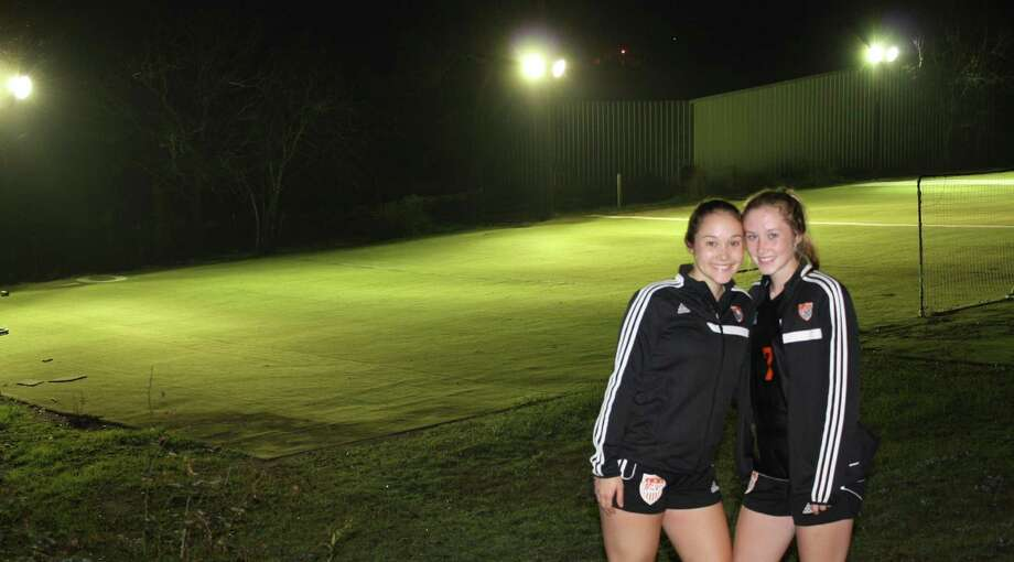 Medina Valley High School soccer players — and sisters — Mackenzie (left) and Audra Clark pose on Feb. 13, 2017, near the lighted field their father, Bobby, built for them in a farm field in Castroville. Photo: Courtesy Photo /Bobby Clark