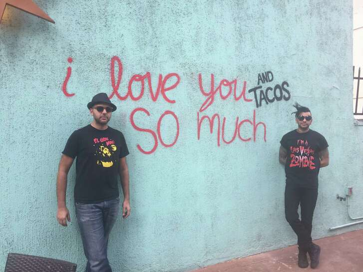 "USE THIS ONE!: El Big Bad in downtown Houston pays homage to the ""I love you so much"" wall in Austin and also San Antonio's reinvented ""I love tacos so much"" recreation with its own tribute. Shown: the wall at El Big Bad with restaurant owner Steve Sharma and his brother Shaun Sharma."