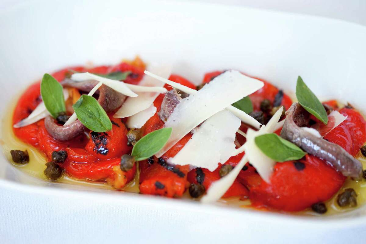 Roasted peppers with anchovies, capers, oregano, shaved grana padano and Vallone's olive oil is one of the new menu items at Tony Vallone's Ciao Bello restaurant. Ciao Bello has a new executive chef, Alan Paryzek.