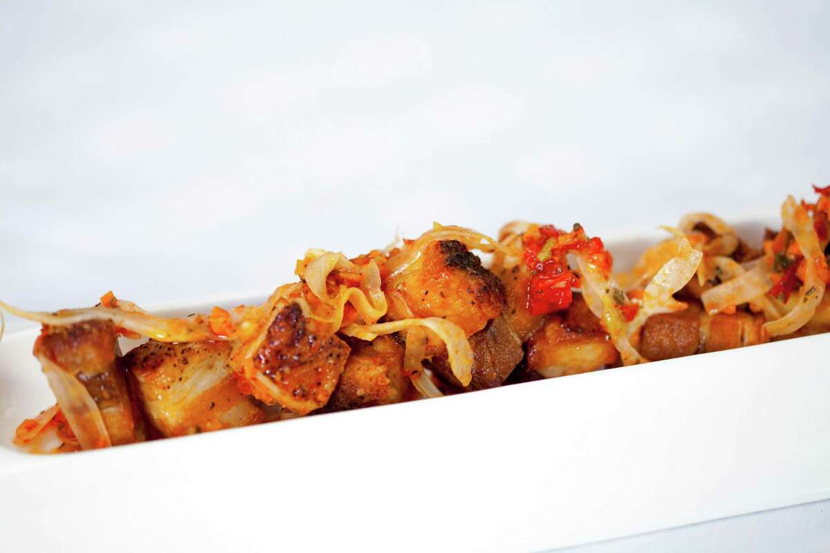 Crispy pork belly with Calabrian chile giardiniera is one of the new menu items at Tony Vallone's Ciao Bello restaurant. Ciao Bello has a new executive chef, Alan Paryzek.