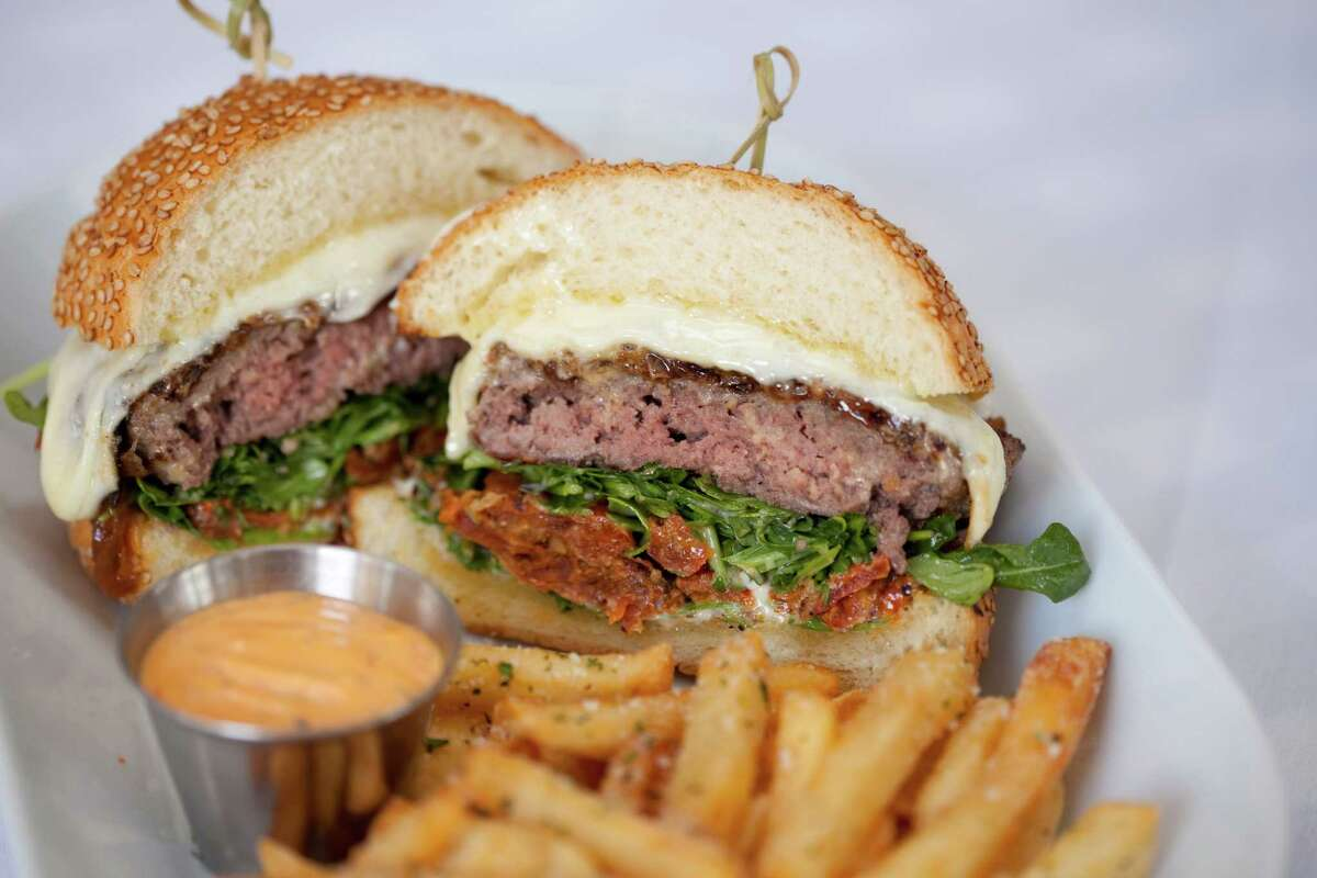 The Bello Burger on a homemade bun with provolone, caramelized onions, slow-roasted tomato,arugula, and white balsamic vinaigrette is one of the new menu items at Tony Vallone's Ciao Bello restaurant. Ciao Bello has a new executive chef, Alan Paryzek.