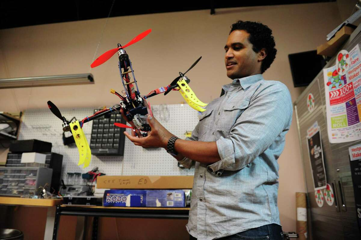 Fairfield County Makers' Guild founder and president Vladimir Mariano, shows a drone fabricated at the community workspace in Norwalk, Conn., on Tuesday Feb. 17, 2016. The workspace provides the tools, technology and expertise to help members' ideas become physical prototypes. Members can use 3D printers, tinker with robots, work with metal lathes and much more.