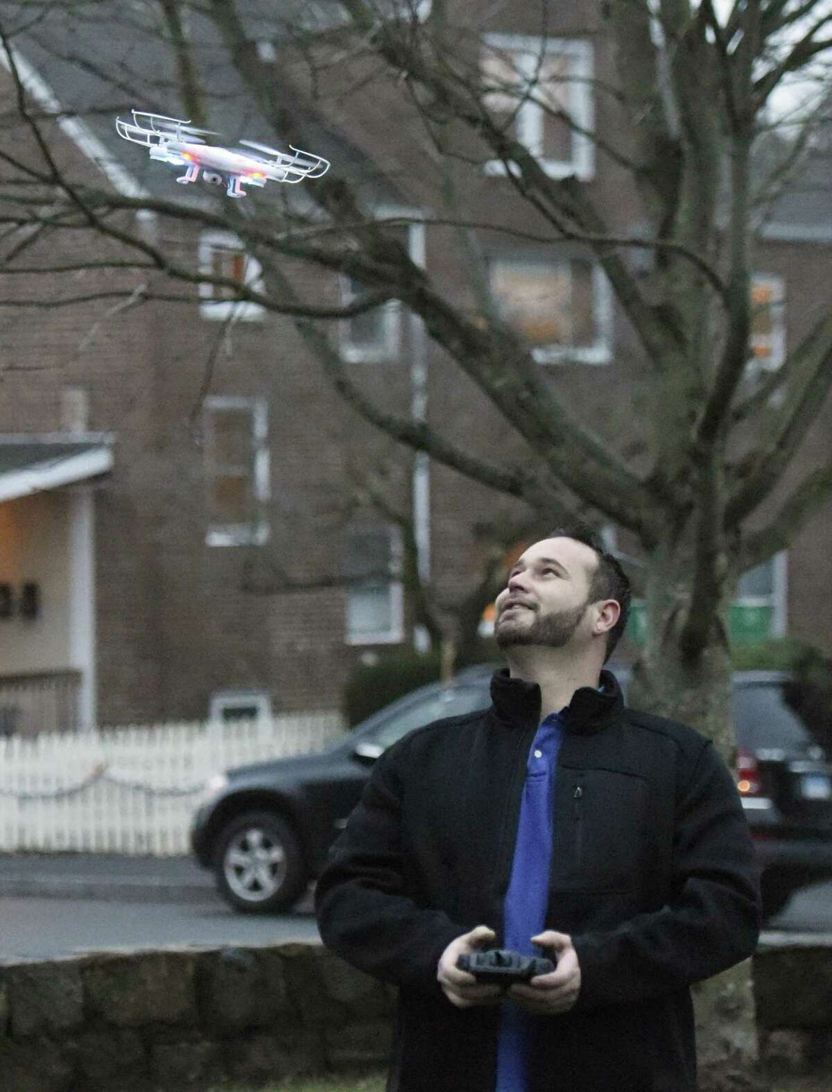Byram resident Anthony Altamirano flies his drone at Pemberwick Park in Greenwich, Conn. Thursday, Dec. 31, 2015. Altamirano, who also flies model airplane and helicopters, received the super-lightweight drone as a Christmas gift.