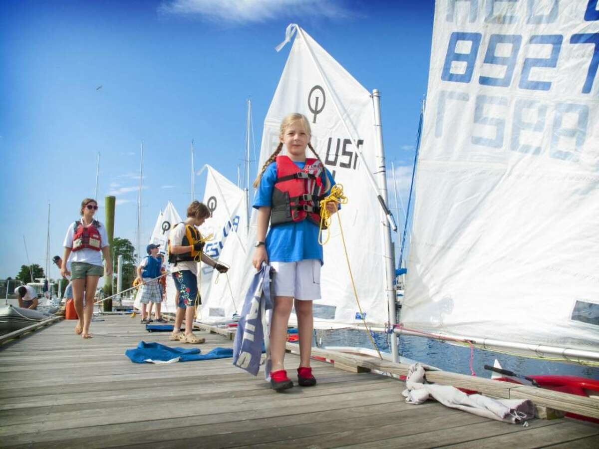 """From day 10 of """"Breaking the Sound Barrier"""" series, Checca Parson, 10, of New York, prepares to rig her Optimist dignhy during the youth sailing program at the Cedar Point Yacht Club in Westport on Monday, June 29, 2009."""