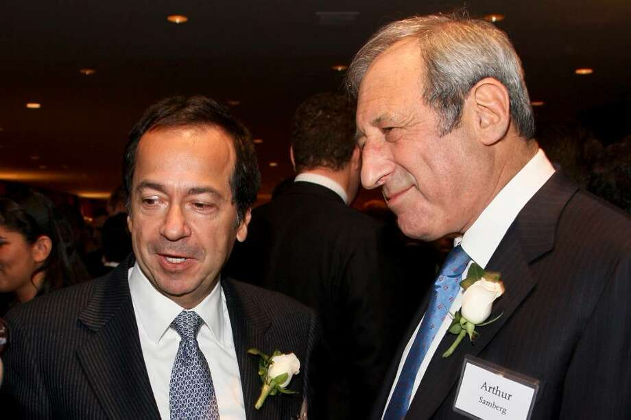 """John A. Paulson, president of Paulson & Co., left, speaks with Arthur """"Art"""" Samberg, chairman of Pequot Capital Management Inc., during the UJA Federation of New York's annual Wall Street Dinner in New York, U.S., on Wednesday, Dec. 16, 2009.  Some observers feel that Paulson, manager of the world's third biggest hedge fund, makes bets that are too big and overly risky.  Samberg's Wilton-based Pequot, once the biggest hedge fund, is being wound down.   Photographer: Rick Maiman/Bloomberg *** Local Caption *** John A. Paulson; Arthur """"Art"""" Samberg Photo: Rick Maiman, ST"""