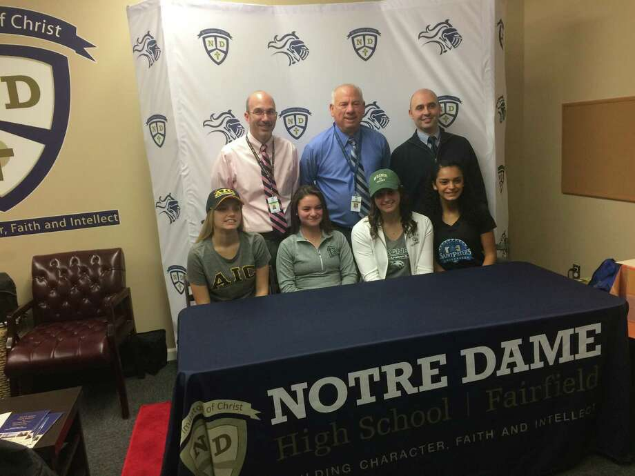 Notre Dame-Fairfield girls' soccer signees: Front row: Brianna Kydes (AIC), Erica Quinones (Post), Samantha LaValle (Wagner) and Nazae Craw (St. Peter's). Back row: Principal Christopher Cipriano, head coach Wayne Mones, athletic director Rob Bleggi. Photo: Contributed / Contributed