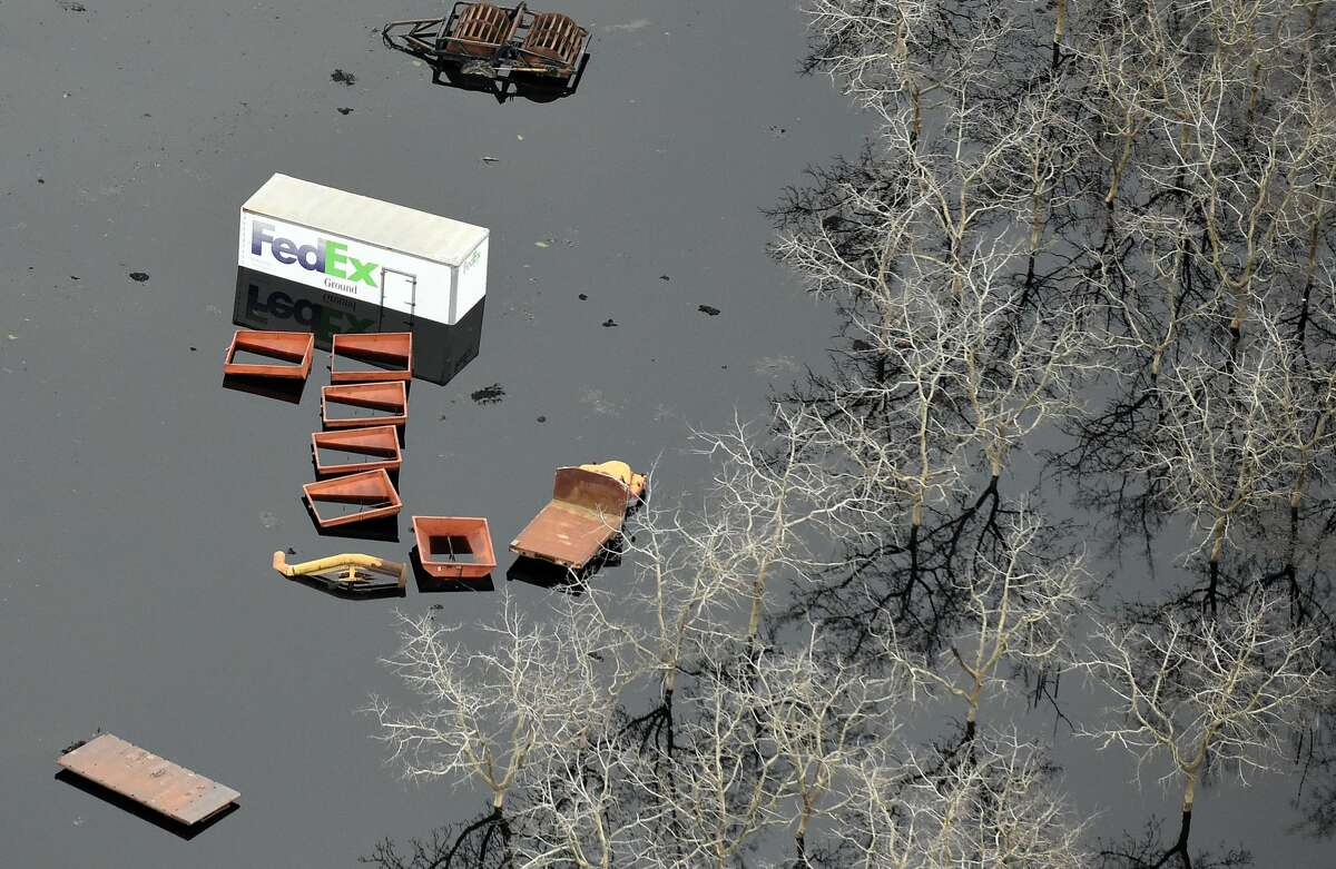 This aerial view shows submerged trucks and farm equipment in flowing water in Oroville, California on February 13, 2017. Almost 200,000 people were under evacuation orders in northern California Monday after a threat of catastrophic failure at the United States' tallest dam. Officials said the threat had subsided for the moment as water levels at the Oroville Dam, 75 miles (120 kilometers) north of Sacramento, have eased. But people were still being told to stay out of the area.