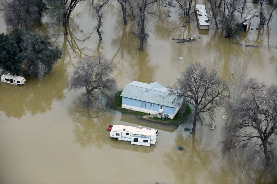 A home is seen marooned as the surrounding property is submerged in flood water in Oroville, California on February 13, 2017.  Almost 200,000 people were under evacuation orders in northern California Monday after a threat of catastrophic failure at the United States' tallest dam. Officials said the threat had subsided for the moment as water levels at the Oroville Dam, 75 miles (120 kilometers) north of Sacramento, have eased. But people were still being told to stay out of the area.  Photo: JOSH EDELSON/AFP/Getty Images