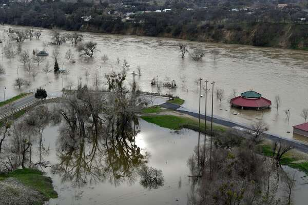Riverbend Park is seen under flood water in Oroville, California on February 13, 2017.  Almost 200,000 people were under evacuation orders in northern California Monday after a threat of catastrophic failure at the United States' tallest dam. Officials said the threat had subsided for the moment as water levels at the Oroville Dam, 75 miles (120 kilometers) north of Sacramento, have eased. But people were still being told to stay out of the area.  / AFP / Josh Edelson        (Photo credit should read JOSH EDELSON/AFP/Getty Images)
